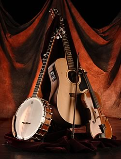 A photo of a banjo, guitar and fiddle
